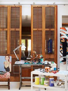 Full height sliding partition made out of shutters, Remodelista.