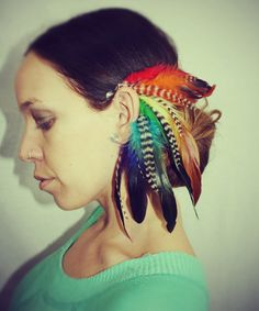 Handmade Rainbow Feather Ear Cuff EarringGrizzly by Cloud9Jewels. $26.00 USD, via Etsy.