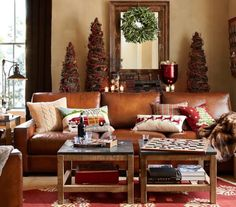 Tan, red, gold for Christmas, bit of ice blue in pillows. Natural elements. Red rug.