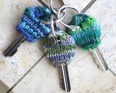 This free knitting pattern offers a fun way to organize your keys.  Knit your own Creative Key Cozies using bits of scrap yarn from your stash.