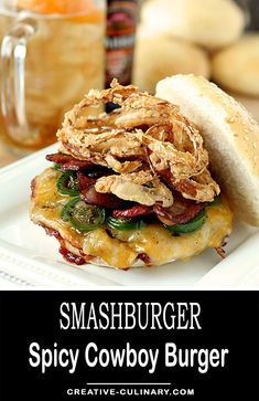 Homemade Smashburger Spicy Cowboy Burger is simply the best with barbecue sauce, cheddar, jalapeno, bacon and crispy onion strings.