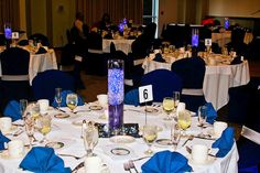 These are centerpieces we made, M.O.R.events for a surprise 50th birthday party.  We made with clear gel beads, blue material, and blue underwater lighting.