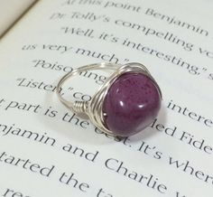 Purple stone ring wrapped in silver by OnTheWireByMaryJane on Etsy, $10.00