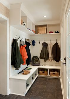 Mudroom backpack storage entry traditional with beige molding beige shelves
