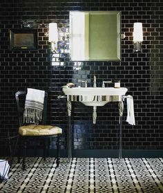 #deco #style. I'm in love with this bathroom since I found it. Domino black gloss mosaic wall tiles and Abbey Woburn floor tiles Atlantic basin and washstand with glass legs Bastide tap and mirror and Xaviera lights. From 2016 #firedearthuk #tile #catalogue awesome!  #uncommontiling #tiles #tiling #construction #constructionwork #tilesamples #refurb #refurbished #interiordesing #interior #interior_desing #renovation #renovations #bath #bathroom #floor #flooring #tilingwork #tileaddiction…