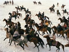Buzkachi I. Kyrgyz men steers their horses in a game of buzkashi, a competition akin to polo — except a headless goat carcass takes the place of the ball. (Matthieu Paley).