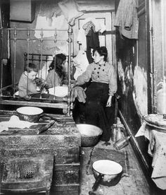 New York tenement apartment with a mother and her two children, photograph by Lewis W. Hine, 1910