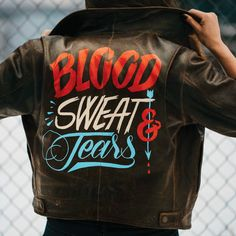 Blood Sweat & Tears is painted in OneShot Lettering enamel on a found leather jacket. A nod to those who take the long, hard, stupid way around; those who take things apart and put them back together in their own way; and those who muck things up to make something worth being proud of. - Jen Mussari