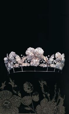 from 1860, a diamond tiara with multiple flower-heads, which come apart to form brooches