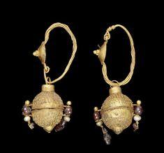 A pair of Parthian gold, garnet and pearl earrings  Circa 3rd Century A.D.
