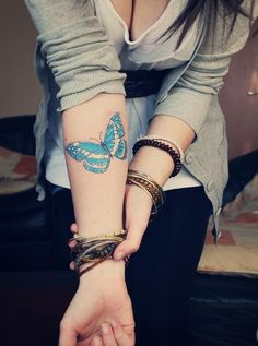 Blue butterfly tattoo.