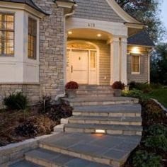 stone home with beautiful walkway! traditional exterior by Stonewood, LLC