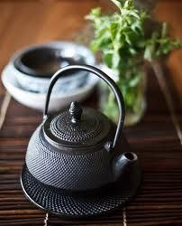 Iron Tea Pots do the best job of keeping your tea hot while it steeps.