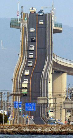 Eshima Ohashi Bridge, Japan The bridge looks more like a roller coaster than a road. The Eshima Ohashi Bridge in Japan rises so. Places To Travel, Places To See, Scary Places, Places Around The World, Around The Worlds, Scary Bridges, Dangerous Roads, Mario Kart, The Good Place