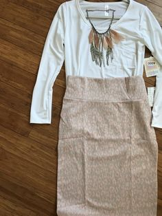 Over 150 LuLaRoe Outfit ideas posted! Including this white Lynnae tee and elegant Cassie pencil skirt! Come check them out! facebook.com/groups/1380641358911229