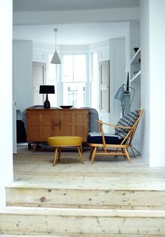 Modern London family home with pine floorboards, ercol armchair and footstool, and gubi floor lamp in the music room Ercol Chair, Ercol Furniture, Home Decor Furniture, Armchair, Pine Wood Flooring, Light Hardwood Floors, Floor Lamp Makeover, Modern Kitchen Renovation, Home Suites
