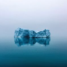 There's something magical about icebergs, like this one in #Greenland's Ilulissat Icefjord, that I am not sure I will ever fully put my finger on, nor get tired of thinking about. Perhaps it's that the ice they are made from could be a millennia old? Or maybe it's their solitary existence, quietly drifting out at sea?