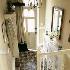 Entrance hallway. Of interest is the chandelier, not sure why curtain is where it is ...