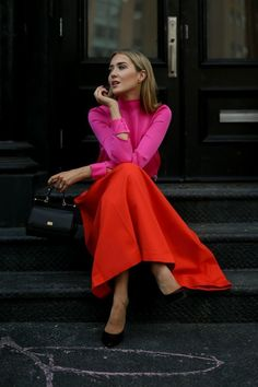 Click for outfit details! Fuchsia pink bow-tie blouse, orange pleated midi skirt, small black sicily bag, classic black pumps + beaded leather belt {Dolce & Gabbana, Milly, Tibi, Saint Laurent, colorblocking, statement dressing, classy dressing, bold colors}