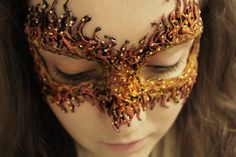 Fire Masquerade Mask made with hot glue. You could do so much with this idea.
