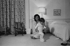 Jackie with her son in the White House living quarters