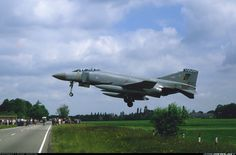 19 sqn Phantom almost hit the public road, but the pilot pushed to full throttle and missed the airfield fence by inches. Airplane Fighter, Fighter Aircraft, Fighter Jets, Military Jets, Military Aircraft, War Jet, F4 Phantom, Aircraft Pictures, Aircraft Images