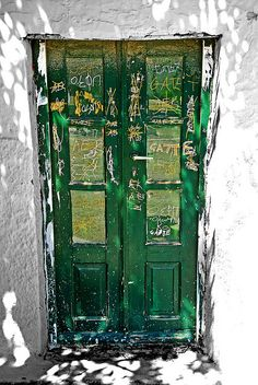 Green Greek door -- I like it because it differs from the archetype of a Santorini blue against the whitewash.