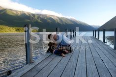 Father and Son on Pier, Nelson Lakes, New Zealand royalty-free stock photo