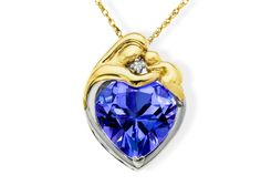 A beautiful way to tell mom that you love her! The perfect gift to show any mother your appreciation. This pendant features a 4 4/8 ct heart-cut created ceylon sapphire and diamond accent set in 14K gold and sterling silver. Piece measures 1/2 by 9/16 inches.