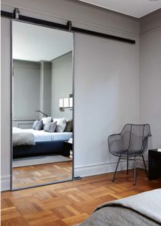 Mirrored bedroom barn door 900x1259 Bedroom Mirror Designs That Reflect Personality