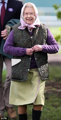 Welly boots and a wool skirt for the Queen, as she walks through Windsor park to watch her horses compete at the Royal Windsor Horse Show in the grounds of Windsor Castle, Berkshire
