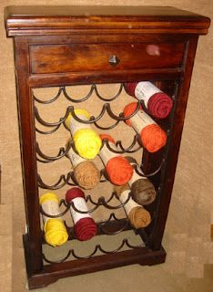 Recycle a wine rack and use it as yarn storage!  I. LOVE. THIS!!!
