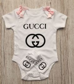 white cotton baby gift set decorated with a black heat applied Vinyl designer inspired motif.bodysuit/vest and scratch mitts . * style of baby wear may vary * Available in Cute Baby Girl Outfits, Baby Outfits Newborn, Cute Baby Clothes, Kids Outfits, Babies Clothes, Babies Stuff, Luxury Baby Clothes, Designer Baby Clothes, Gucci Baby Clothes