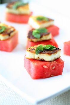 fresh basil, fresh mint, garlic, extra-virgin olive oil and Halloumi cheese over watermelon.