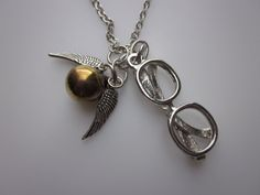 A Gold Winged Snitch Necklace with Eyeglasses Charm by luckysparks, $8.99 I'M IN LOVE!!!!!