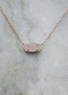 "Shown in rose gold/iridescent druzy. Size: 0.63""L x 0.38""W stationary pendant, 15"" chain with 2"" extender. 14K Gold Plated Over Brass. Lobster claw closure. Please note: Due to the one-of-a-kind natur"