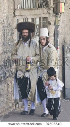 JERUSALEM - MAR. 09 : Ultra Orthodox family during Purim in Mea Shearim Jerusalem on Mar. 09 2012 , Purim is a Jewish holiday celebrates the salvation of the jews from jenocide in ancient Persia - stock photo