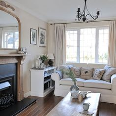 Mirror really help to lighten up this room - Cream and oak living room