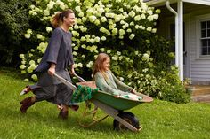 "Easy Living - ""I feel like a more fully rounded woman here,"" says Maran, pictured taking Rumi for a spin in the house's rustic wheelbarrow. ""It's nice when I get to be that way with my family. Way Of Life, Life Is Good, Rustic Wheelbarrows, Molly Sims, Beautiful Farm, Josie Maran, Farm Photo, Urban Homesteading, Daughter Love"