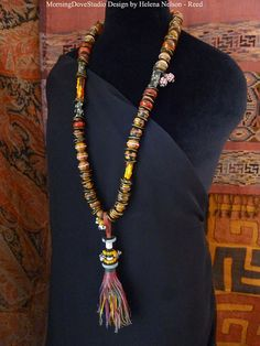Tribal and ethnic bead long dramatic with flirty African tribal made leather tassel