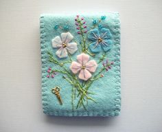 Blue Needle Book Felt Organizer with Flowers Hand Embroidered Hand Sewn. $26.00, via Etsy.