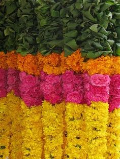 Marigold garland with mango leaves. Love anything India inspired.