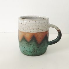 Teal Mountain Ceramic Mug, wheel thrown coffee mug, stoneware speckled pottery mug geometric mountain design teal pottery turquoise ceramic by TheLuluBird on Etsy https://www.etsy.com/listing/507552333/teal-mountain-ceramic-mug-wheel-thrown