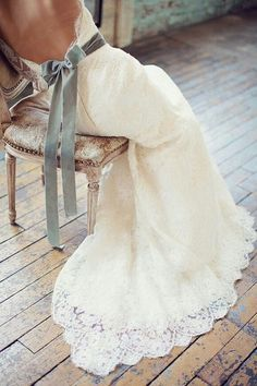 Dior Couture wedding gown with a low-cut back and a satin ribbon around the middle!