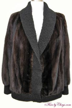 Mahogany Mink Jacket #MM705; $800.00; Excellent Condition; Size range: 8 - 12. This is an enchanting genuine natural mahogany mink fur jacket. It features knitted shawl collar and front trim, bracelet cuffs and hem -- very stylish. The lining is solid black and there is a monogram. It closes with hooks and eyes. This is a very practical style of mink jacket that may be worn both casually as well as to more dressy events. You will reach for this gorgeous mahogany mink fur jacket again and again!