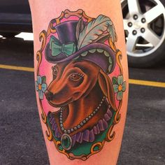 "Love, love, love! This is exactly what I'm going for with my pet dedication tattoo... a ""cameo"" style oval with my 3 pets, dressed up in some way. (I actually have a dachshund so this is too perfect.) I would want this to be quite large and on my upper right thigh."