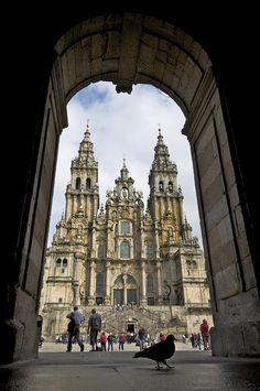 ✮ Exterior view of a Gothic cathedral's facade through an archway
