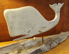 Whale on driftwood stand by Jac & Patricia Johnson