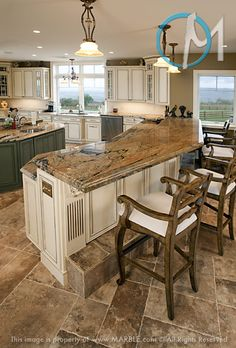 The angled peninsula features laminated Peregrine granite. The flowing pattern is perfect for such an application.  I will have this .kitchen someday