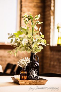 Growlers and Red Stripe wedding centerpieces. Baby's breath and eucalyptus decor Growlers and Red Stripe wedding centerpieces. Baby's breath and eucalyptus decor. Beer Bottle Centerpieces, Floral Centerpieces, Wedding Centerpieces, Wedding Reception Decorations, Wedding Ideas, Reception Ideas, Wedding Table, Wedding Planning, Wedding Inspiration